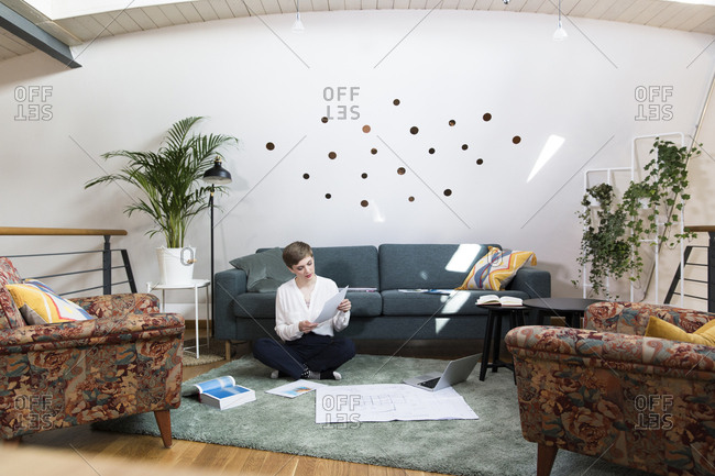 Woman working on project in modern office