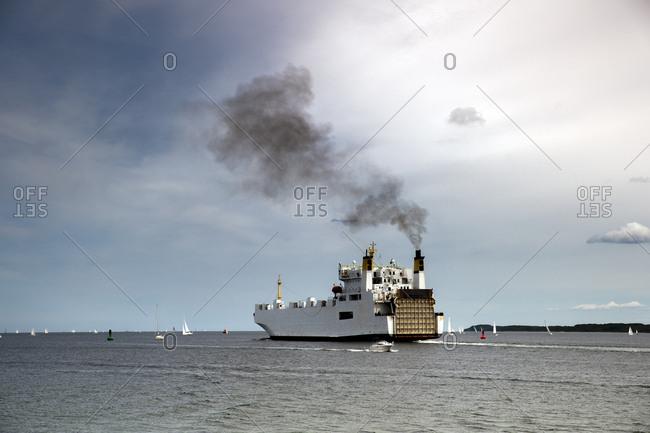 Germany- Travemuende- ferry on the sea emitting smoke