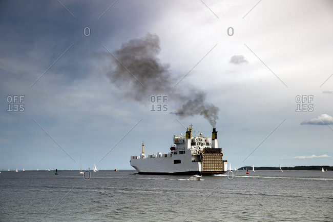 Germany- Travemuende- ferry on the sea emitting smoke