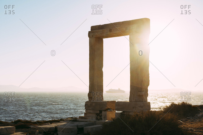 Greece- Cyclades- Naxos- Gate to the temple of Apollo at sunset