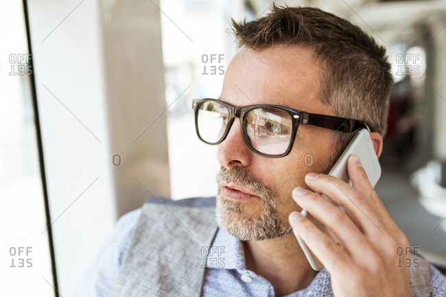 Businessman on smartphone in tram