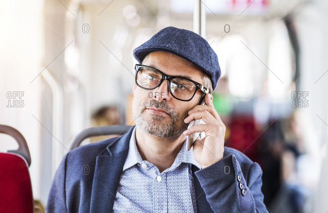 Man on smartphone in bus