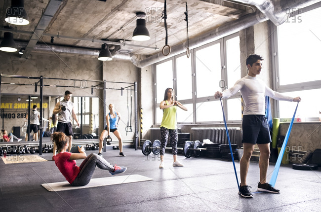 Group of young people exercising in gym