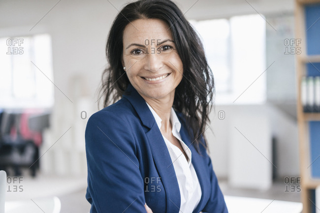Portrait of smiling woman in a loft