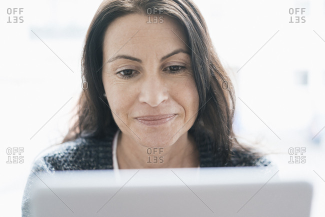 Portrait of woman looking at tablet