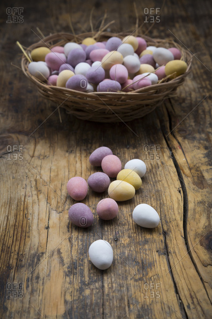Easter nest of Chocolate Easter eggs on wood