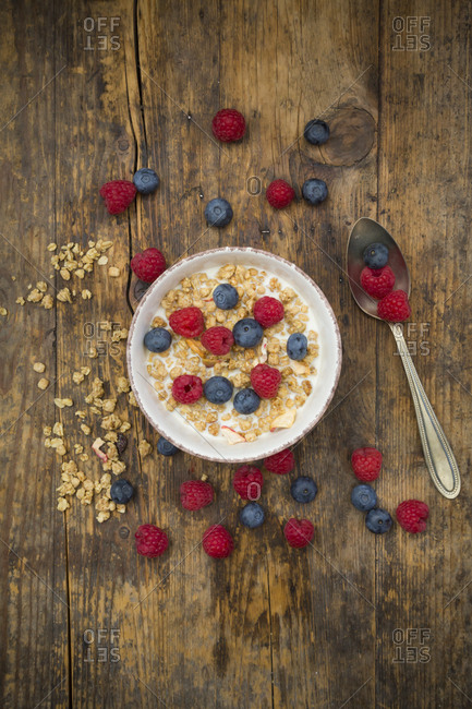 Bowl of granola with raspberries and blueberries