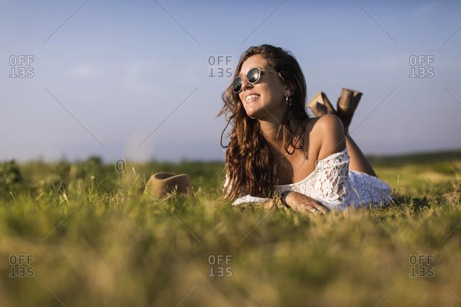Happy woman lying in a field