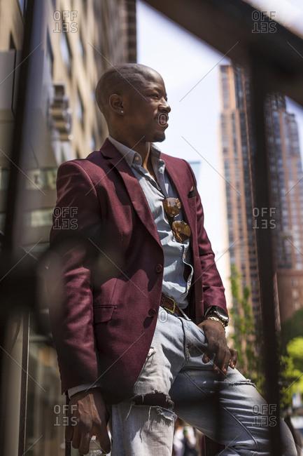USA- New York City- Manhattan- smiling businessman