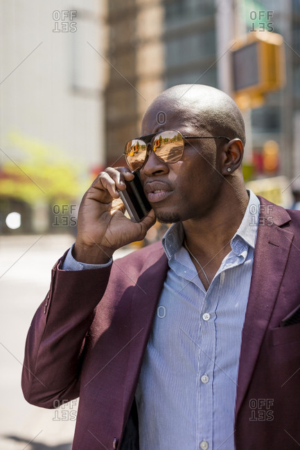USA- New York City- Manhattan- portrait of businessman on the phone