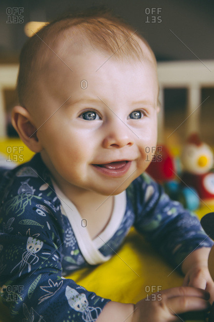 Portrait of happy baby boy in his crib