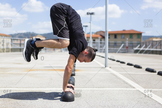 Man exercising Parkour discipline in the city