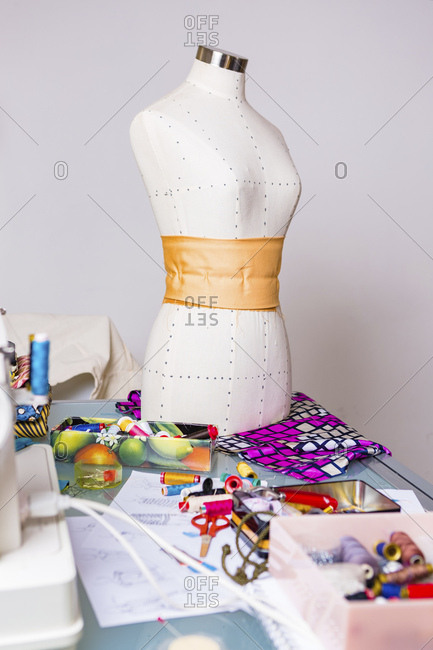 Fashion designer's working table with mannequin and equipment