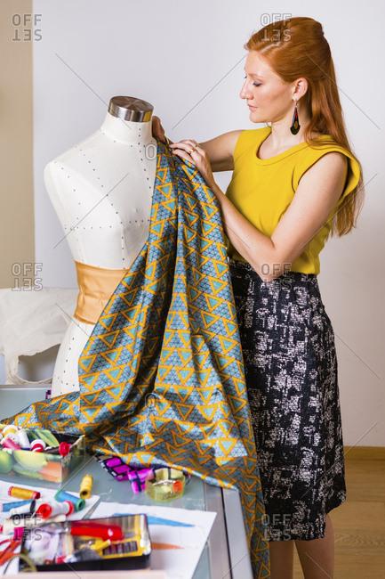 Fashion designer working at mannequin