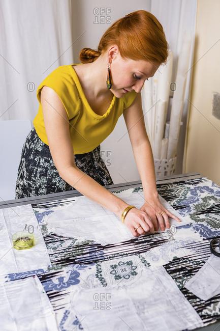 Fashion designer working on template