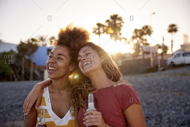 Two best friends having fun on the beach