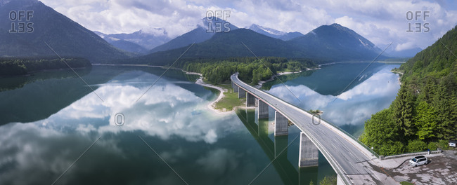 Germany- Bavaria- Sylvenstein dam and bridge with the Alps in background