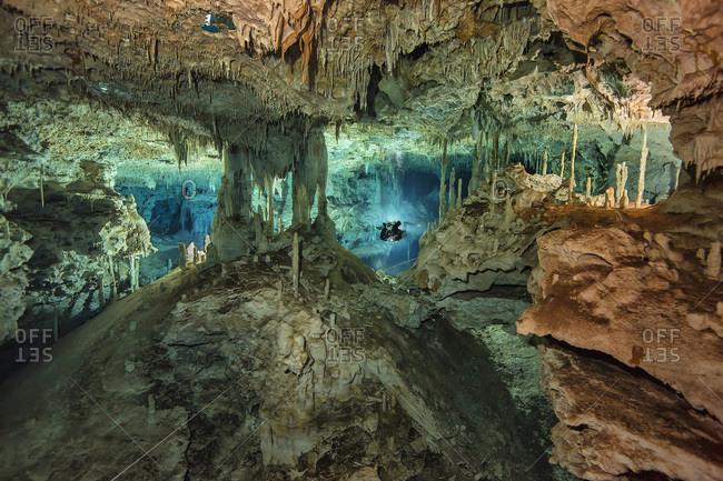 Mexico- Yucatan- cave diver exploring the cenote system Dos Pisos