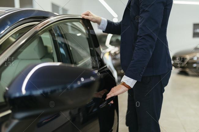 Customer looking at car in car dealership
