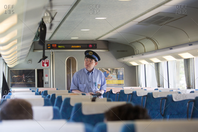 July 14, 2017 - Wakayama, Japan: Train conductor collecting tickets