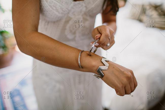 Bride putting on bracelets