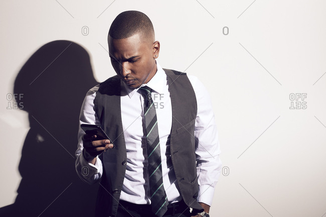 Well dressed man using smart phone