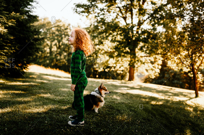 Child and dog looking opposite directions