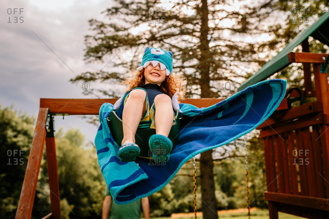 Boy with monster towel swinging