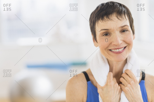 Portrait of mature woman in gym