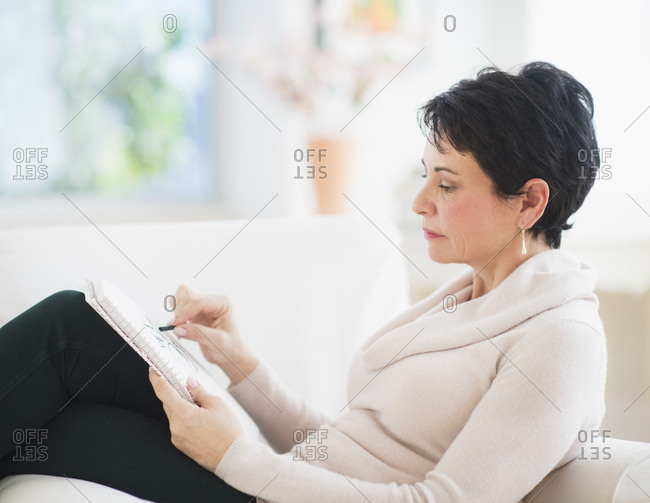 Portrait of mature woman drawing