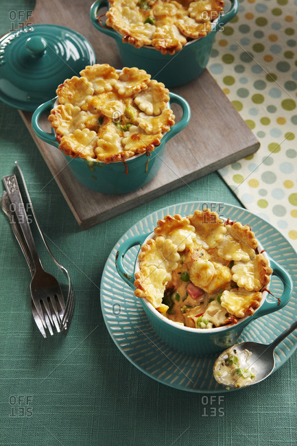 Chicken pot pies in dishes