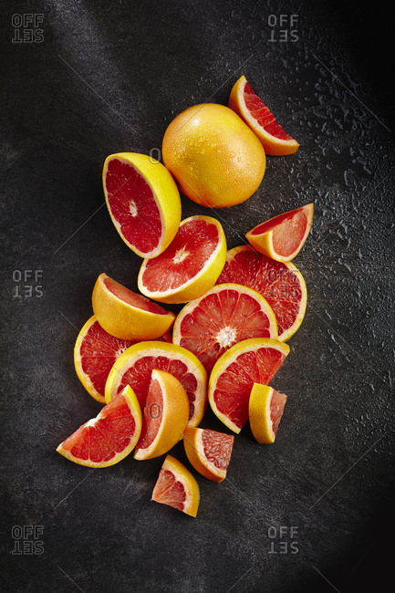 A pile of sliced grapefruits