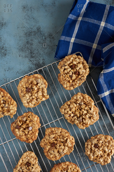Gluten free oatmeal chocolate chip cookies of chickpea batter arranged on a cooling rack.