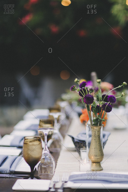 Flowers on table at an outdoor wedding reception