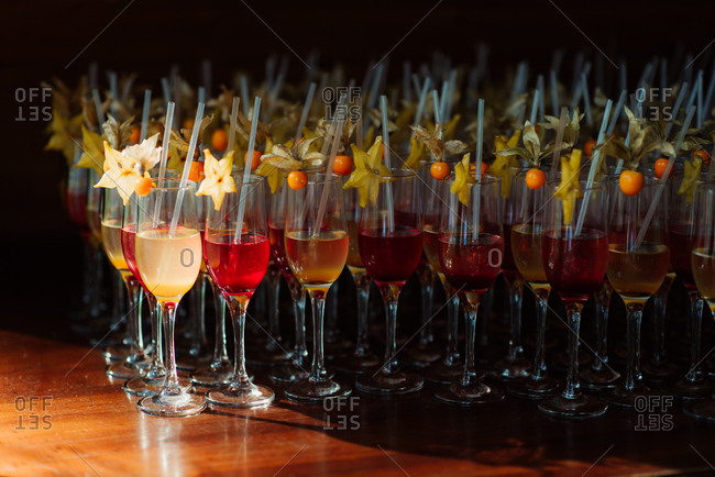 Colorful wedding cocktails garnished with starfruit
