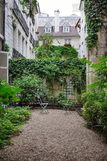Paris, France - May 24, 2011: Two empty chairs in a residential courtyard