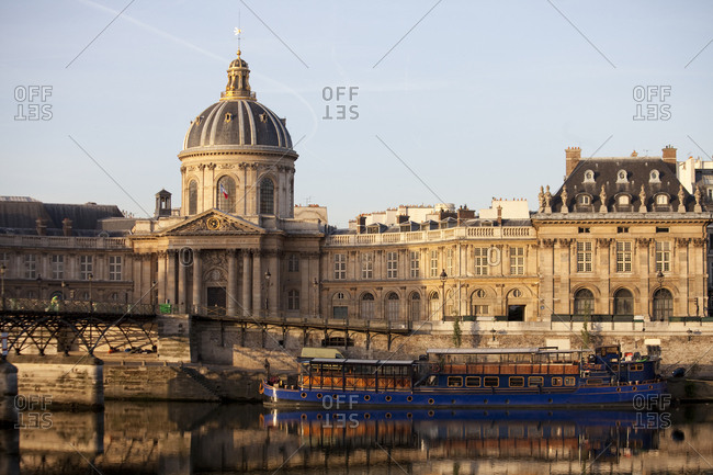 Paris, France - May 23, 2011: A boat on the Seine River in front of the Academie Francaise