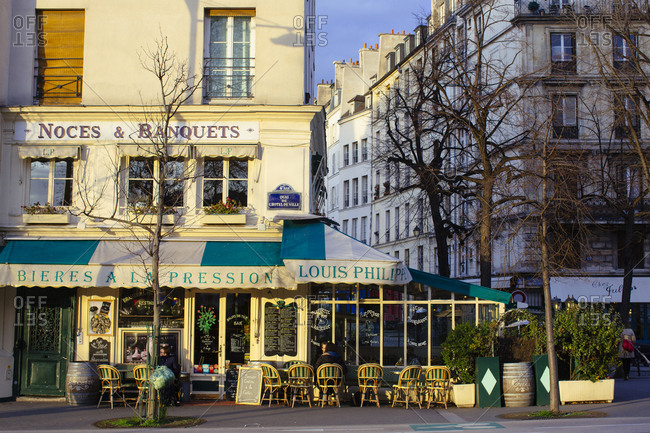 Paris, France - March 4, 2014: People dining outside the Louis Philippe restaurant