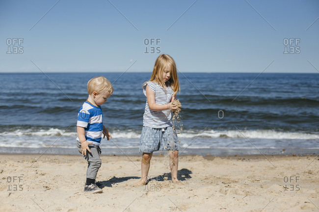 Girl and boy play at beach