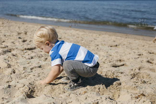 Little boy plays in the sand