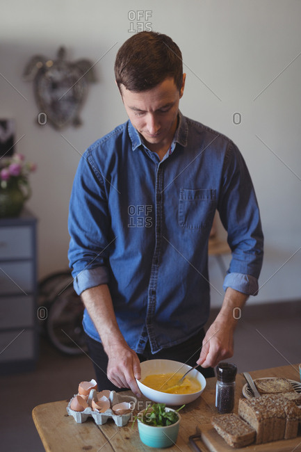 Man preparing breakfast at home