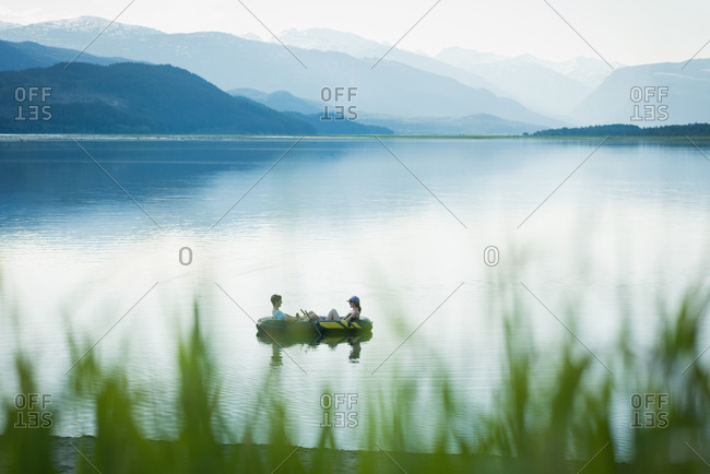 Couple boating on a river at countryside