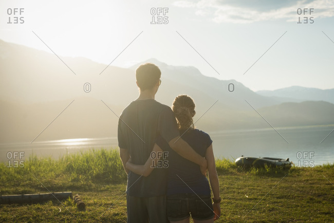 Rear view of couple looking at a view on a sunny day