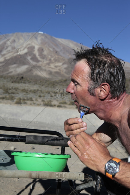 Kilimanjaro, Kilimanjaro, Tanzania - August 27, 2013: Man shaving with primitive sources on the slopes of kilimanjaro