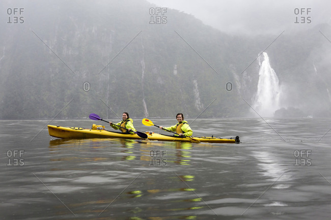 Millford Sound, New Zealand - January 24, 2016: Two kayakers kayaking