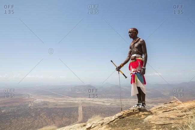 Samburu, Kenya - March 23, 2016: Samburu warrior standing at top of mount ololokwe in kenya