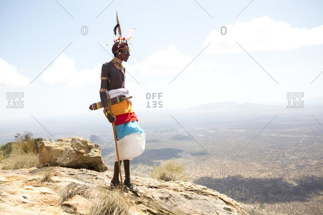 Samburu, Kenya - March 23, 2016: Samburu warrior standing at top of mount ololokwe