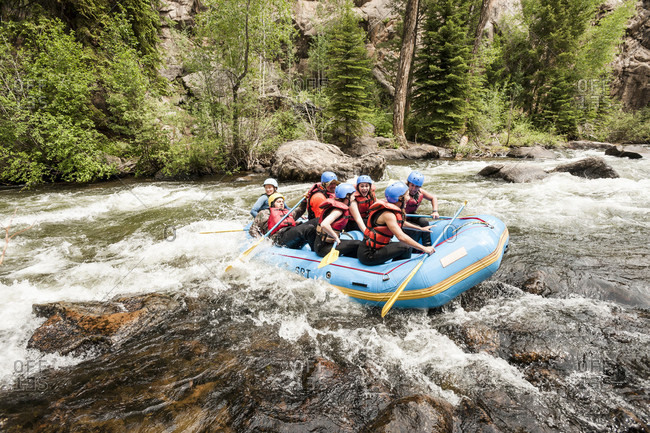 Taylor river, Colorado, USA - June 22, 2016: People rafting on taylor river in colorado, usa