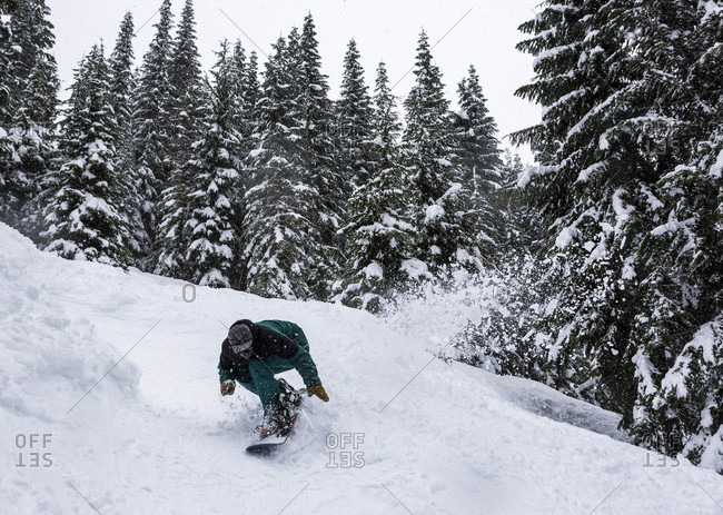 Mount Baker, Washington, USA - February 19, 2016: Man snowboarding at mount baker in washington