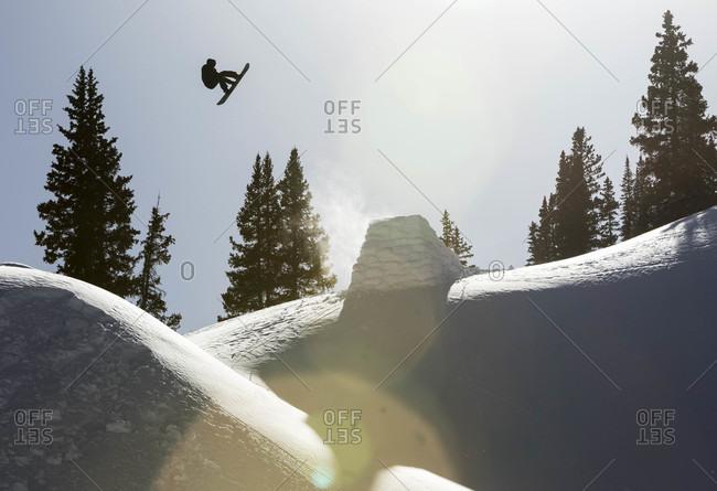 Silverton, Colorado, USA - March 7, 2015: Man snowboarding on red mountain pass in colorado